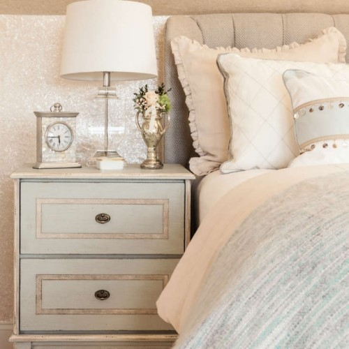 bed with bedside table lamp and clock in Harwich Port MA