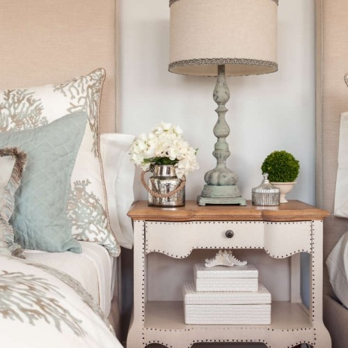 bedside table with lamp and décor in New Seabury MA
