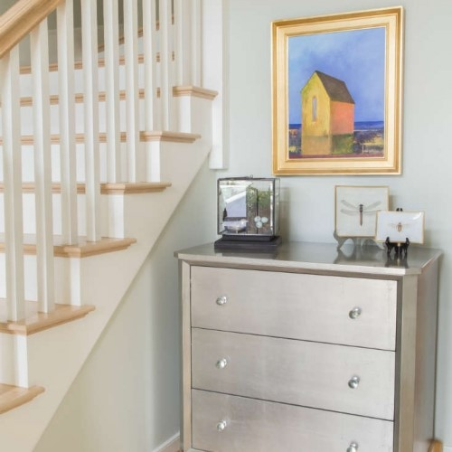 dresser and pictures in nook next to stairs in Yarmouth Port MA