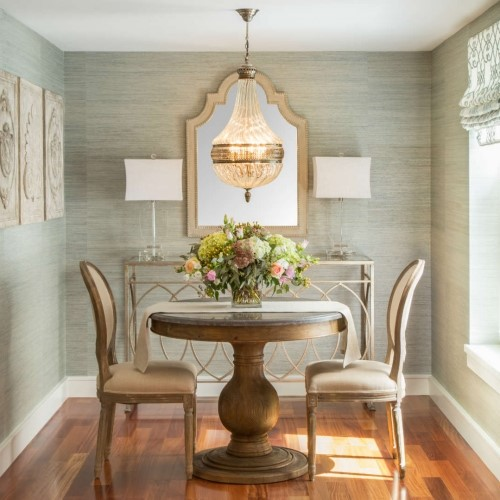 elegant dining room table with chairs mirror and chandelier in Yarmouth MA